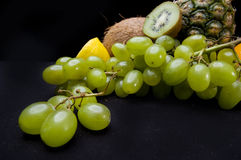 Fruits on black background  in studio. Grapes Stock Photography