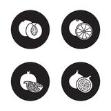 Fruits black icons set. Half sliced peach with seed and cut into pieces pomegranate  symbols.Orange and fig fruit. White silhouettes illustrations on black Royalty Free Stock Images