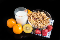 Fruits blancs de granola sur le noir Photos stock