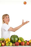 Fruits and blond cute woman Stock Image