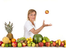 Fruits and blond cute woman Royalty Free Stock Photo