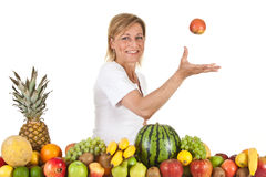 Fruits and blond cute woman Stock Photos