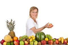 Fruits and blond cute woman Stock Images