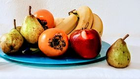 Fruits on plate still life ,aplle bananas pears photo art. Fruits on blue plate still life , organic apple bananas pears photo art royalty free stock image