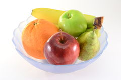 Fruits in a bowl. Fresh fruits in a bowl, isolated on white Stock Images