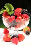 Fruits. Bowl with berry fruit - strawberry, raspberry, black berry and, red currant stock images
