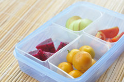 Fruits on The Box. The box is contain mini orange, dragon fruit, apple, tomato. Suits as healthy breakfast Stock Image
