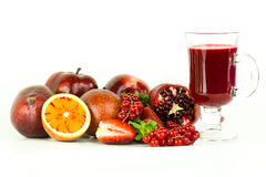 Fruits. A bunch of fresh red fruits and a glass of juice royalty free stock images