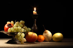 Fruits And Candle Stock Image