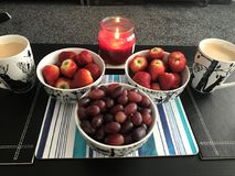 Fruits by the candle together royalty free stock image