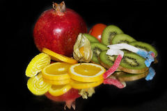 Fruits and candy Stock Images