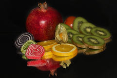 Fruits and candy Stock Photography