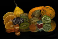 Fruits,candy and pumpkins Royalty Free Stock Images
