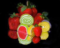 Fruits and candys Stock Photos