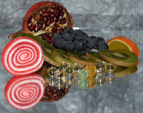 Fruits with candys Stock Photo