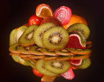 Fruits with candys Royalty Free Stock Photos