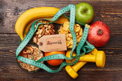Fruits, cereals and sport equiment. Success comes to persevering Royalty Free Stock Images