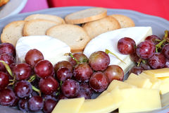 Fruits and cheese platter-Stock photos. Fresh grapes, cracker and cheese platter Stock Images