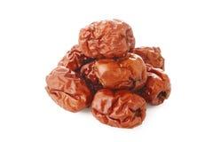 Fruits chinois secs de jujubes sur le blanc Photo stock
