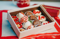 Fruits in chocolate in the box on the table Stock Photos