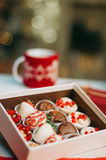 Fruits in chocolate in the box on the table Royalty Free Stock Image