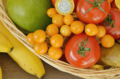 Fruits and chocolate coins in the basket Royalty Free Stock Photos