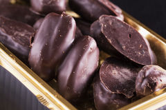 Fruits in chocolate Stock Images
