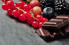 Fruits and chocolate Stock Images