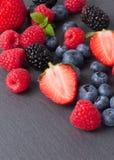 Fruits and chocolate. On gray slate Royalty Free Stock Image