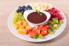 Fruits and chocolate sauce Stock Image