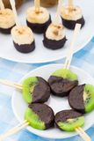 Fruits with chocolate on a stick Royalty Free Stock Photo