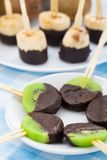 Fruits with chocolate on a stick Royalty Free Stock Photos
