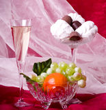 Fruits, chocolate and wine on vase Royalty Free Stock Photos