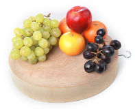 Fruits on chopping board Royalty Free Stock Photos