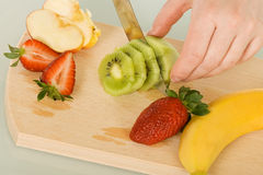 Fruits on chopping board Royalty Free Stock Photo