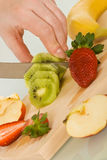 Fruits on chopping board Stock Images