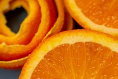 Fruits citrus an orange and a peel or pieces of tangerine. Macro image and close-up, concept for healthy food. royalty free stock images