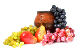 Fruits and clay pottery Royalty Free Stock Photo
