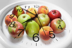 Fruits and Clock Royalty Free Stock Photos
