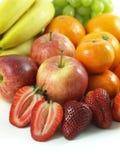 Fruits - close-up. Variety of fruits: apples, strawberries, oranges, bananas, grapes royalty free stock photo