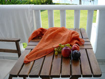 Fruits and the cloth on the table. Fruits and the cloth on the wooden table stock images