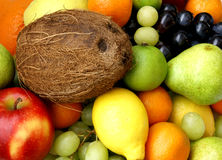 Fruits and coco. Closeup of coco nut and different fresh tasty fruits royalty free stock photo