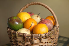 Fruits collected in brown wicker basket Stock Image