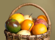 Fruits collected in brown wicker basket  Royalty Free Stock Image