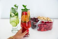 Fruits colorful cocktails. Colorful cocktails with seasonal fruits royalty free stock photos