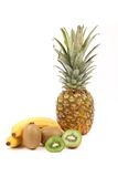 Fruits composition. Banana pineapple and kiwis. White background stock images