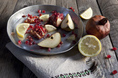 Fruits composition with pomegranate lemon and pear on silver vintage tray Stock Photography