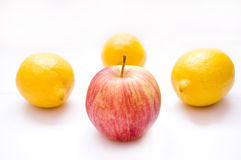 Fruits conceptual image. Apple among lemons on isolated background Stock Photography
