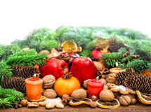 Fruits, cookies nuts and spices with christmas tree branches Stock Photo