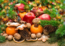 Fruits, cookies and spices. Christmas background with lights royalty free stock photography